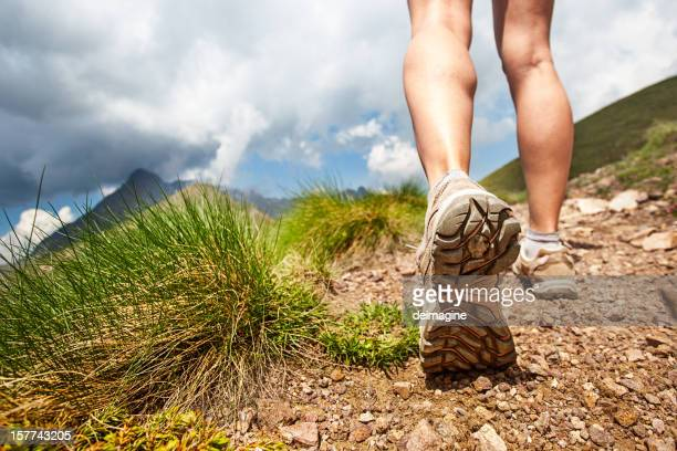 hiker walks on mountain trail - hiking boot stock pictures, royalty-free photos & images