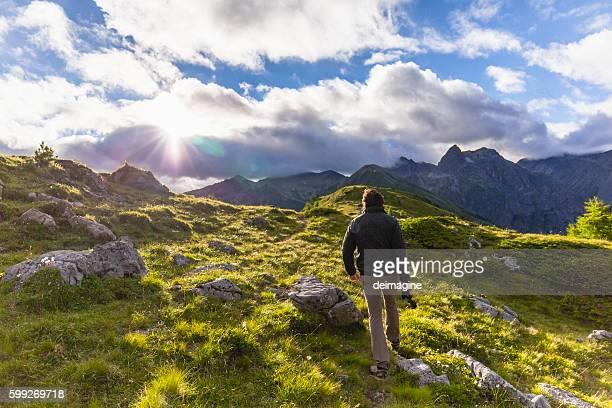 Hiker walks on the mountain path