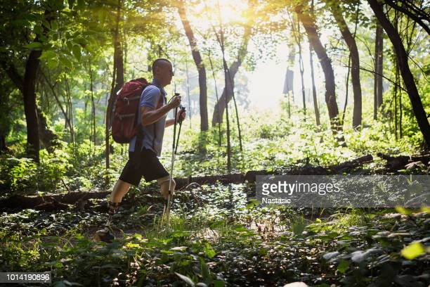 Hiker with artificial legs hiking in nature