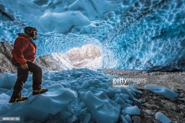 Hiker with crampon in ice cave - Eiskapelle Nationalpark Berchtesgaden