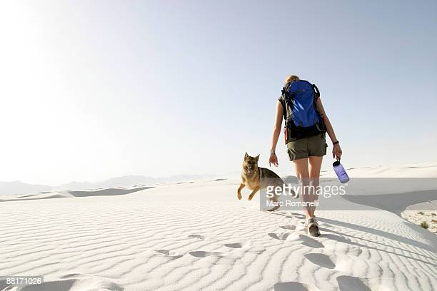 Hiker with dog in desert