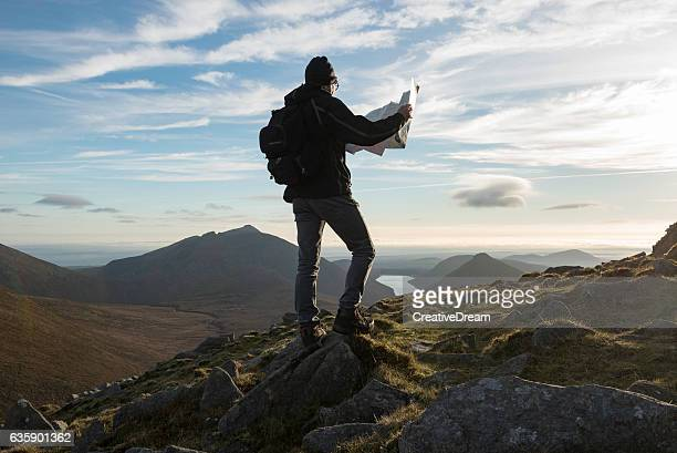 Hiker with map Mourne Mountains, Northern Ireland