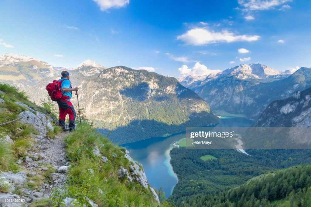 Hiker with view to Lake Königssee and St Bartholomä, Nationalpark Berchtesgaden : Stock Photo