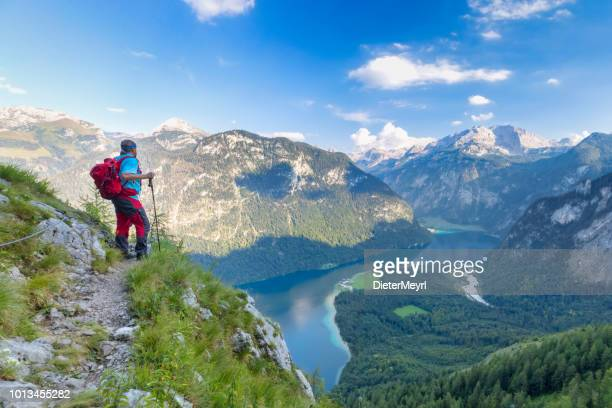 Hiker with view to Lake Königssee and St Bartholomä, Nationalpark Berchtesgaden