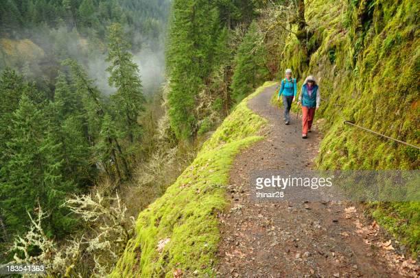 Hikers along steep trail