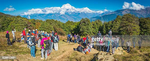 hikers and sherpas on annapurna circuit below dhaulagiri himalayas nepal - pokhara stock pictures, royalty-free photos & images