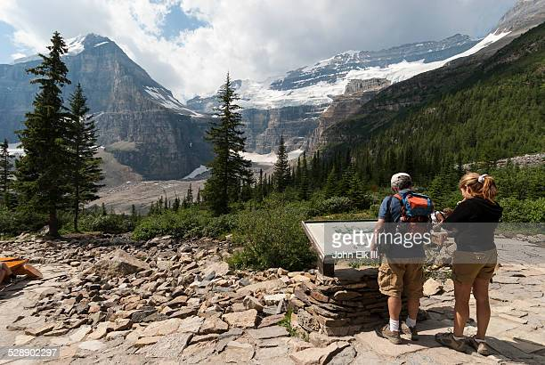 Hikers at Plain of Six Glaciers trail lookout