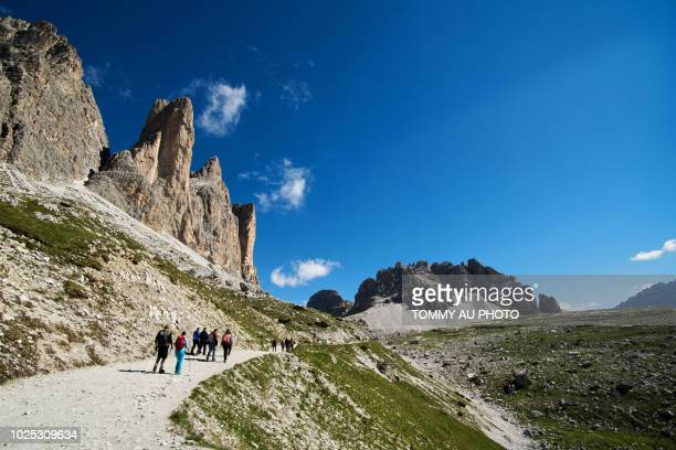 hikers at three peaks of lavaredo, italy - wide angle stock pictures, royalty-free photos & images