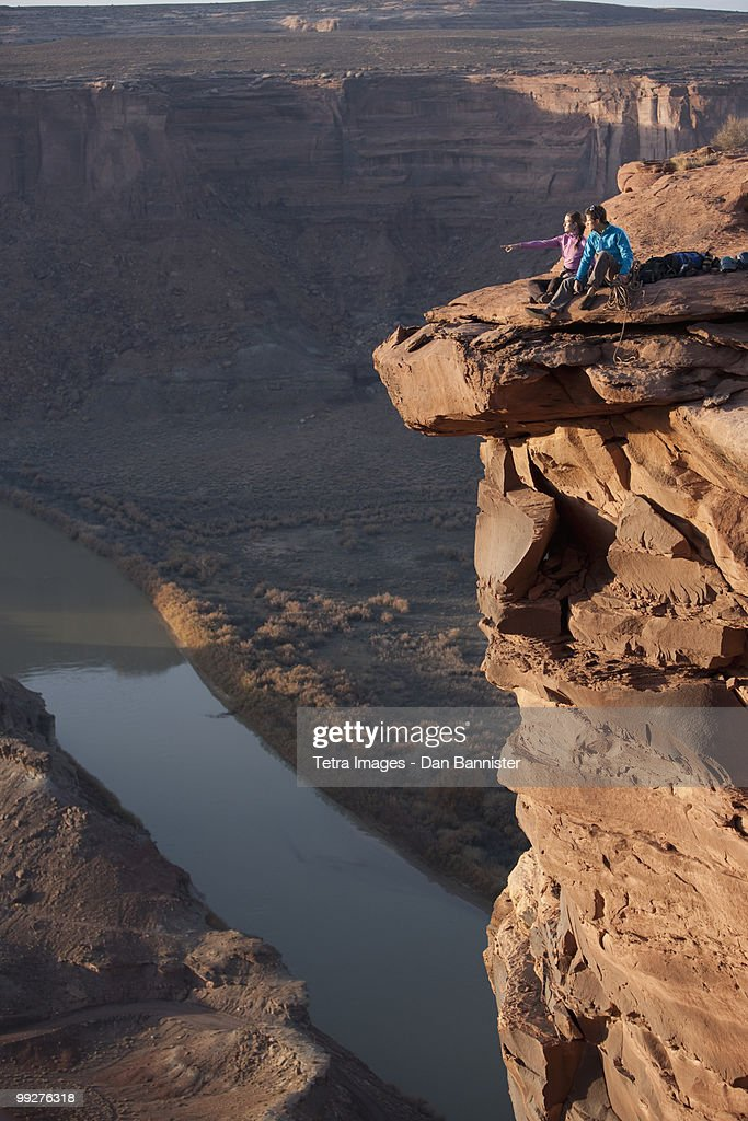Hikers at top of cliff : Stock Photo