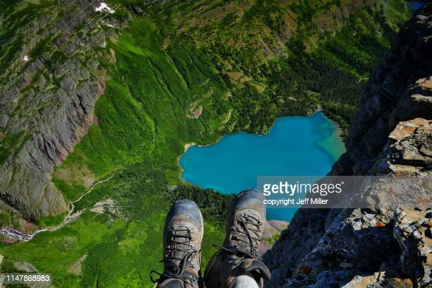 Hikers Boots Hanging above Grinnell Lake, Glacier National Park, Montana, USA.