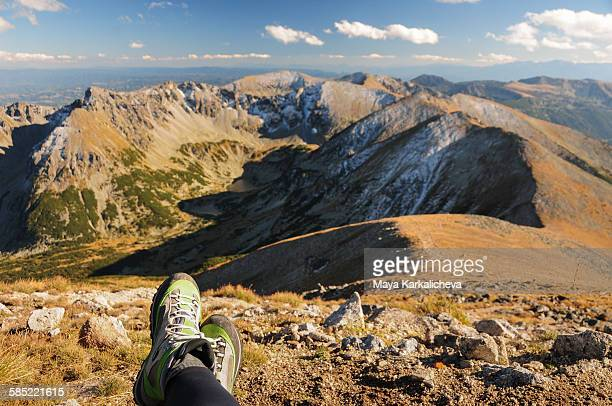 Hikers boots resting on a mountain top