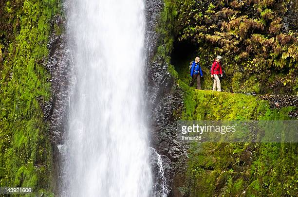 hikers by waterfall - columbia river gorge stock pictures, royalty-free photos & images