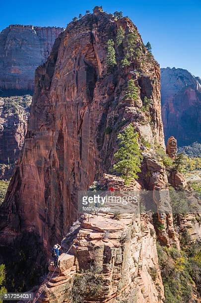 Hikers climbing Angel Landing precipitous path Zion Canyon National Park