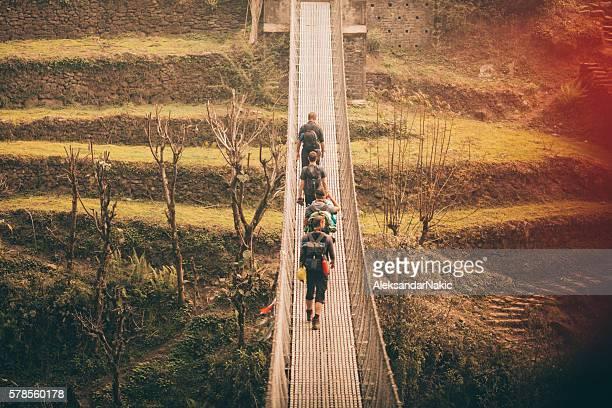 Hikers crossing the footbridge
