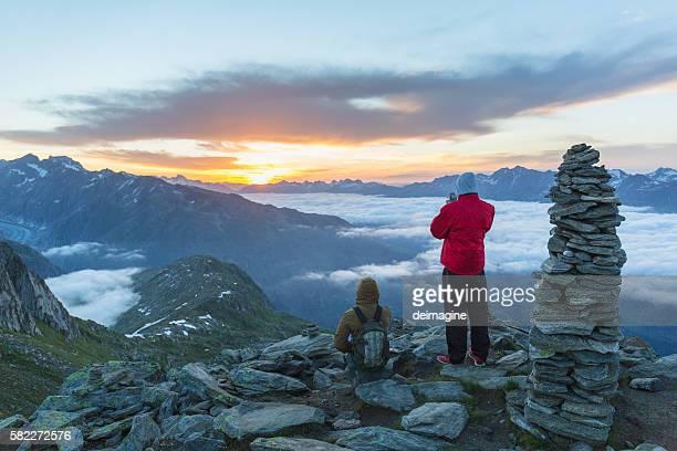 Hikers enjoy mountain sunrise