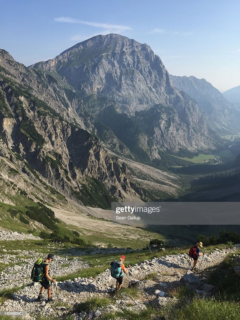 Hikers, family members of the photographer, on day four of a four-day, 50km hike across the Karwendel mountain range descend into the Falzthurntal valley on August 10, 2015 near Pertisau, Austria. The Karwendel mountain range, part of the Austrian Alps, is located in central Tyrol and is a popular summer destination for mountain bikers, climbers and hikers. Mountain huts operated by alpine clubs and scattered across the region offer food and shelter.