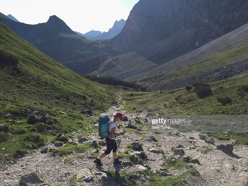 Hikers, family members of the photographer, on day three of a four-day, 50km hike across the Karwendel mountain range walk from Falkenhuette hut to Lamsenjochhuette hut on August 9, 2015 near Eng Alm, Austria. The Karwendel mountain range, part of the Austrian Alps, is located in central Tyrol and is a popular summer destination for mountain bikers, climbers and hikers. Mountain huts operated by alpine clubs and scattered across the region offer food and shelter.