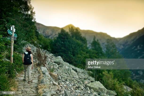 Hikers in a rocky path with signals at Pyrenees.