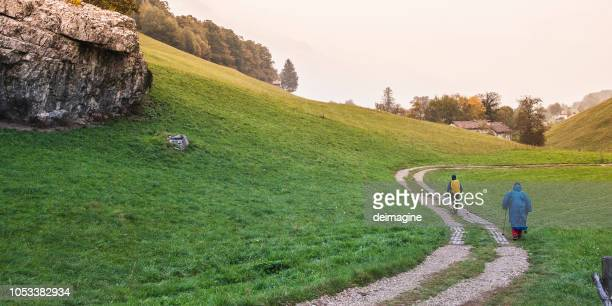 hikers in the hill while raining - pilgrim stock pictures, royalty-free photos & images