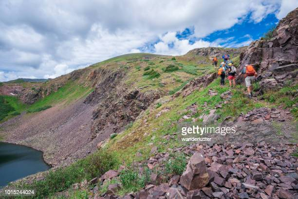 hikers in weminuche wilderness, colorado - san juan mountains stock photos and pictures