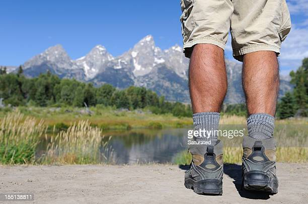 Hikers Legs Overlooking Mountain and River