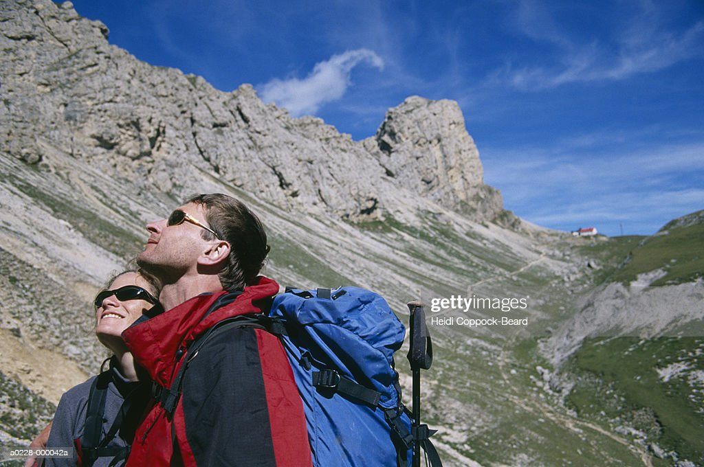 Hikers Looking Up : Stock Photo