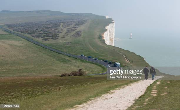 hikers near beachy head light house - national landmark stock pictures, royalty-free photos & images