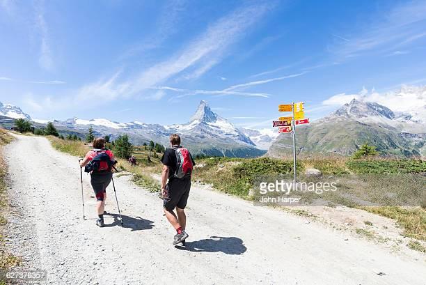 Hikers near Matterhorn in the Alps.