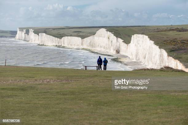 Hikers near the Seven Sisters Cliffs