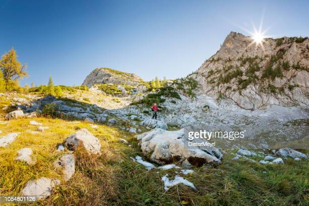hikers on a mountain trail at berchtesgaden national park near koenigssee- landtal - königssee bavaria stock photos and pictures