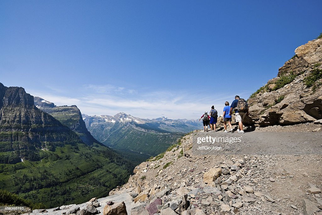 Hikers on a Narrow Ledge : Stock Photo