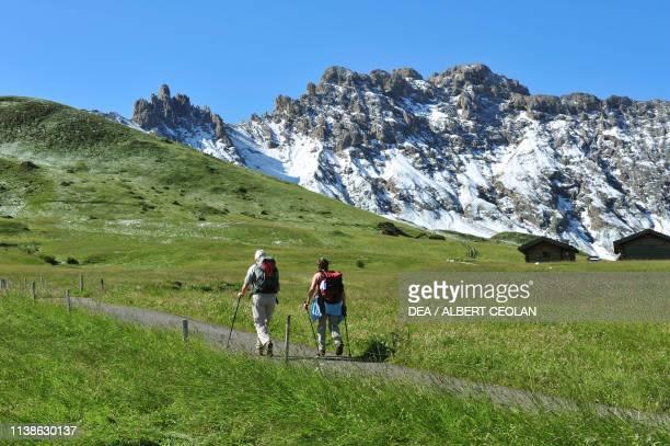 Hikers on a path in the Seiser Alm SchlernRosengarten Nature Park Dolomites TrentinoAlto Adige Italy