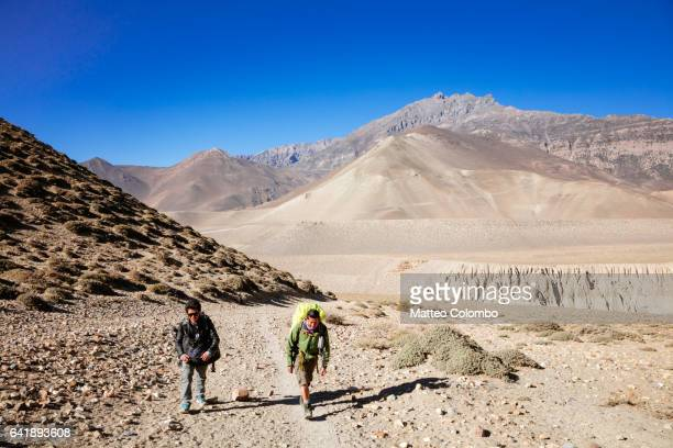 Hikers on a track, Upper Mustang region, Nepal