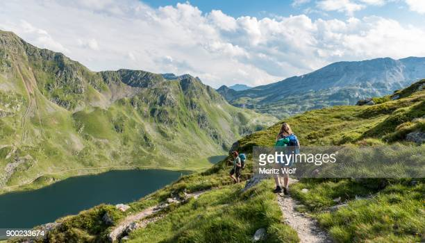 Hikers on a trail, Giglachseen, Schladming Tauern, Schladming, Styria, Austria