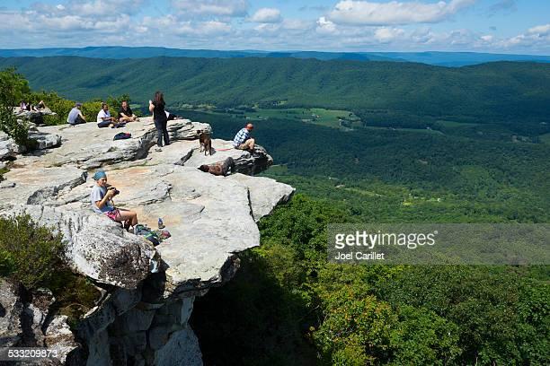 Hikers on Appalachian Trail at McAfee Knob on Catawba Mountain