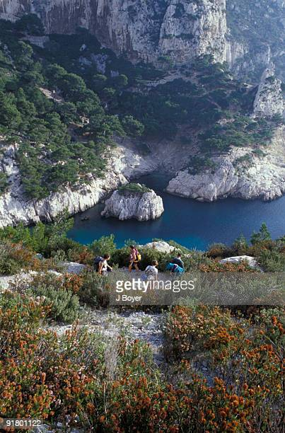 hikers on cliff, marseille, france - calanques stock pictures, royalty-free photos & images