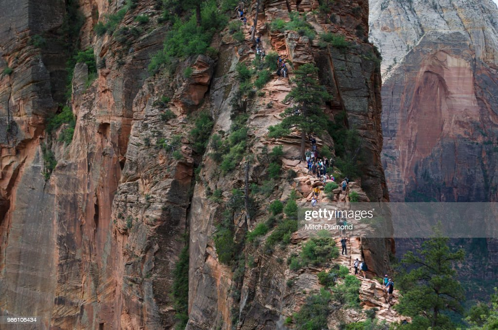 hikers on dangerous angels landing stock photo getty images