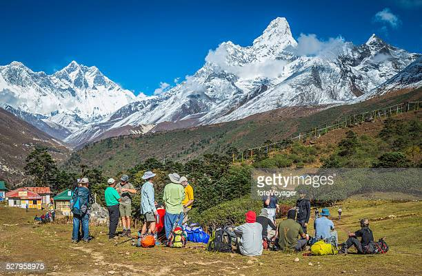 Hikers on Everest Base Camp trail below Himalaya mountains Nepal