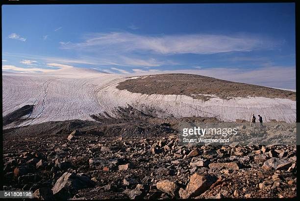 hikers on itirbilung fjord - baffin island stock pictures, royalty-free photos & images