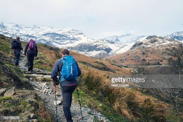 Hikers on mountain, Coniston, Cumbria, United Kingdom