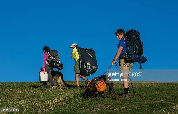 Hikers on the Appalachian Trail head to the top of Max Patch a bald mountain with scenic views on October 8 2015 near Hot Springs North Carolina...