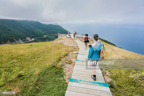hikers on the skyline trail. - cape breton island stock pictures, royalty-free photos & images