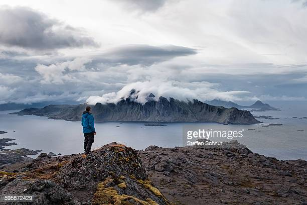 Hikers on the summit in spectacular scenery Norway