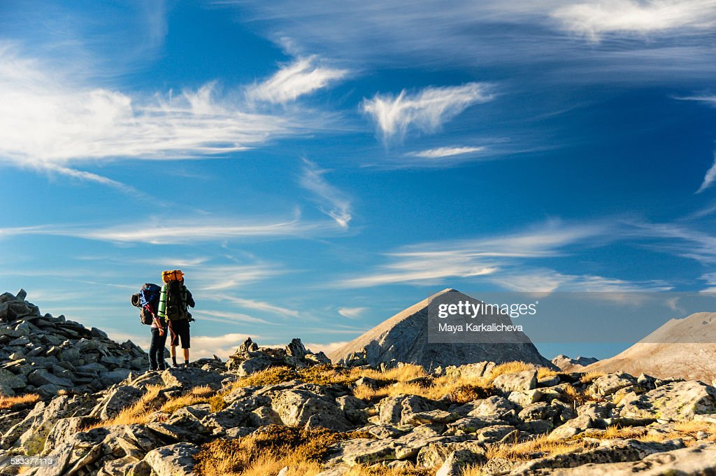 Hikers on top of a mountain : Stock Photo