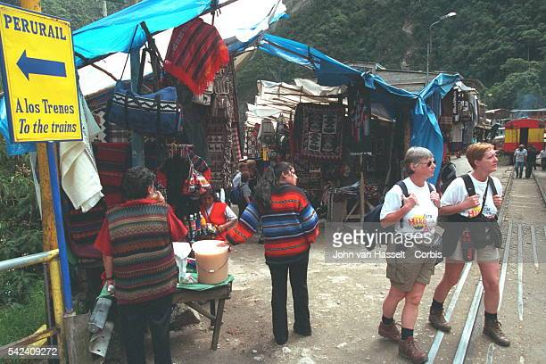 Hikers pass through the city of Aguas Calientes on their way to the Machu Picchu archaeological site | Location Peru