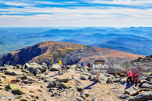 Hikers reach the summit of Mt Washington