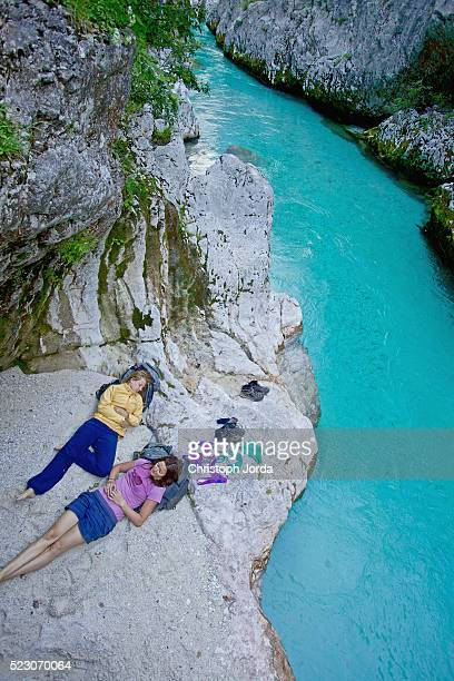 Hikers resting by mountain stream