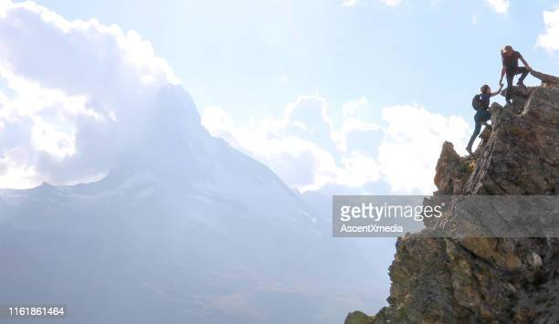 hikers scramble up steep hillside near the matterhorn peak - high section stock pictures, royalty-free photos & images