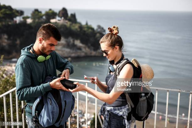 hikers setting up music on bluetooth speaker and smart phone - bluetooth stock pictures, royalty-free photos & images