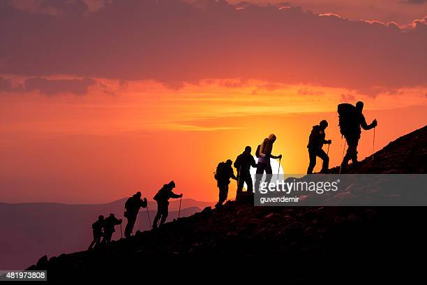 Hikers Silhouetted At Sunset
